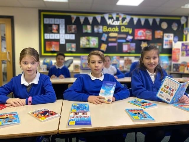 School children with books on World Book Day